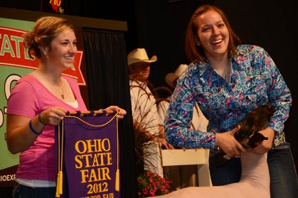 Emily Overs finished her 4-H career on a high, setting a record price for her 2012 Grand Champion Lamb.