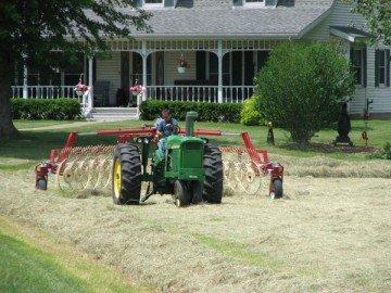 Mike Bush raking hay.