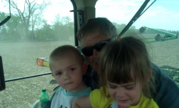 Adalyn and Gavyn helping their papaw plant at Derck farms near Antwerp,Ohio.