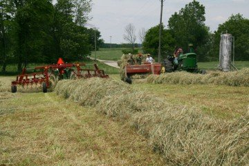 It was so windy that raking had to take place right before the hay was baled.