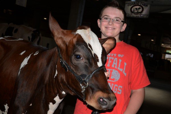 Maylon Conrad, from Pickaway County, had fun at the fair with Joyce, an Ayrshire fall calf.