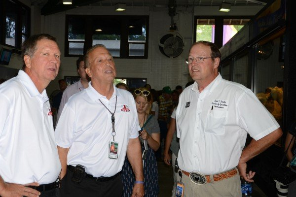 Gov. John Kasich, Virgil Strickler and Dave Daniels mull over the ice cream offerings next to the butter cow display.