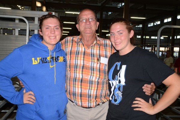 Denny Miller purchased a lamb at the sale in memory of his good friend Mark Banbury. He is pictured here with Mark's daughters Madison and Taylor.