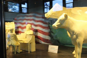 The butter sculpture is addition to the traditional cow and calf sculpture.
