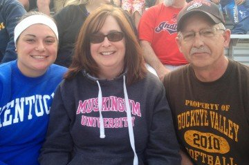 Beth and her husband Mike enjoy watching her daughter Marla, left, play softball.