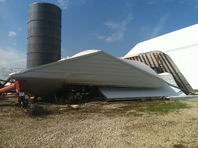 A machinery building north of Celina is held up only by the semi underneath.