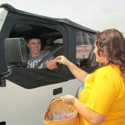 "FFA member Rebekah Eidmiller (right) gives a ""Smartie"" to Mack Rose for wearing his seatbelt."
