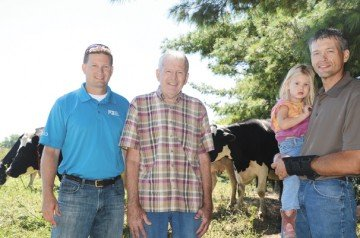 Adam, Don, and Kyle Sharp work together on their organic grass-based dairy farm in Fairfield County. Kyle gets a little help from daughter Kylee too.