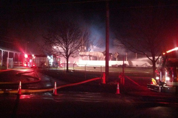 Friday night, Greenville fire crews work to put out a fire that destroyed a beef barn on the Darke County Fairgrounds.