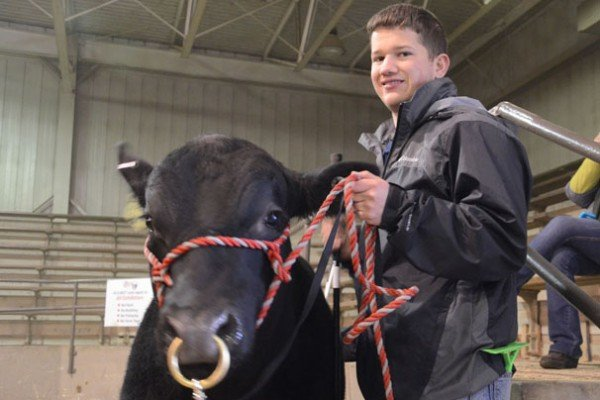 Max McCoy from Pleasant View Farm in Ravenswood, West Virginia with his Angus bull.