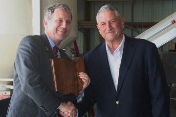 Senator Sherrod Brown receives the Ohio Soybean Council Legislator of the Year Award from OSA President Jerry Bambauer