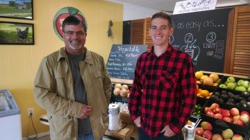 Lee Lichtenwalner, owner of Dandelion Lane Farm and Ambassador with Farmer Veteran Coalition, discusses future product sales with Quinn Colella, former Marine and owner of All Good Things Natural Market in nearby Washingtonville, Ohio.