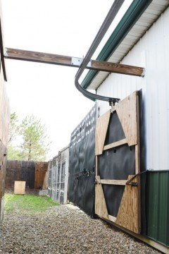 "Waldvogel built ""walls"" that slide along an overhead rail to move the deer into the handling facilities with little to no human contact."