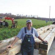 Randy Smith salvages barn wood.