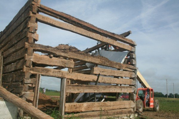 "Ohio Valley Barn Salvage disassembles a barn that was built as early as the 1830's. The barn is a ""dog trot"" style that was common for that time."