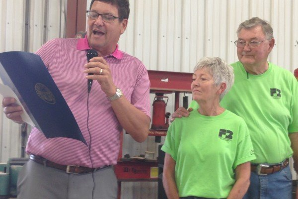 Ron and Nancy Ratliff receive The Century Farm Award from The Ohio Department of Agriculture's John Schlichter.