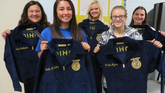 Five 8th graders and freshmen FFA members proudly display their new personalized FFA jackets, which were made possible through the Anthony Wayne FFA Alumni.