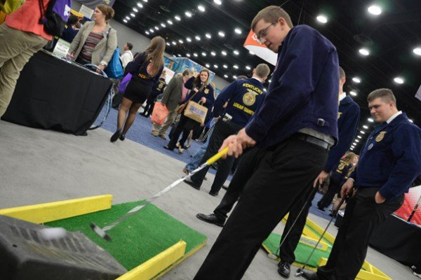 Devon Hoellrich, Miller City Chapter, tries his hand at putt-putt in the trade show.