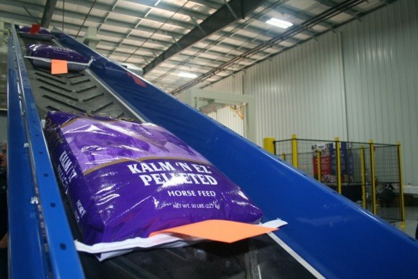 A one-of-its-kind palletizer is featured inside the new packaging facility at Kalmbach Feeds.