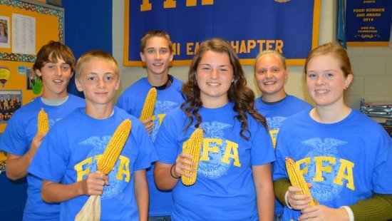 Winners of the annual Corn Contest were (front row, L to R) Dylan Hahn, Kira Cron, Bridey Logan, (back row, L to R) Trey Rush, Dave Wright, and Katie Bodenmiller