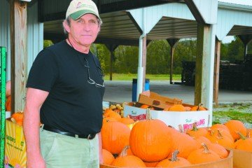 Kelly Brown enjoys serving both buyers and sellers at the Owl Creek Produce Auction.