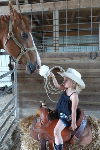 The 2014 Farm and Fair Photo Contest winner was Nancy Keiser from Arcanum who submitted a photo of her granddaughter Katie with Moe the horse. For her winning entry, Keiser received a pass for free admission to all 2015 Ohio fairs courtesy of the Ohio Fair Managers Association.