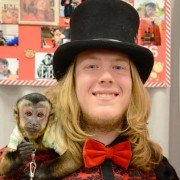 """Jesse """"Monkeyman"""" Moore with one of his Sunshine Monkeyshine monkeys entertained Ohio Fair Managers Convention attendees."""