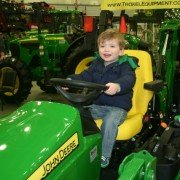 A future farmer tests some Deere gear at the 2015 Fort Wayne Farm Show