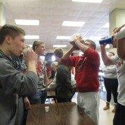 During the milk chug contest, senior boys work hard to win against the juniors.