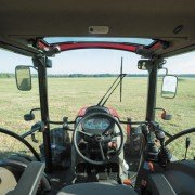 The Farmall 100A series tractors are designed for better comfort and control.