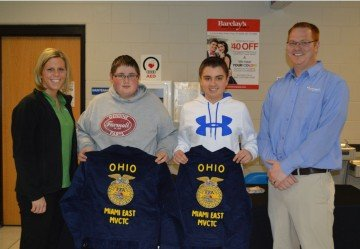 FFA Jackets were donated to Lane Davis (left) and Zac Gordon (right) from the Farm Credit Services of Mid-America