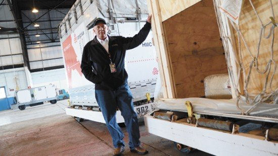 Larry Baker, owner of Baker Livestock in Darke County, has a long history in the business of exporting livestock. He is standing by one of the custom built shipping containers for livestock at Rickenbacker International Airport.