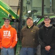 Chris Sprang, Chad Strouse, and Justin Lorentz after the Tractor Troubleshooting contest