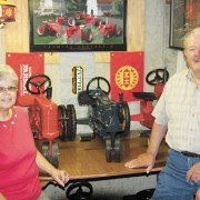 Howard and Carol Garber, with their pedal tractor collection, have overcome their marital differences when it comes to old tractors.