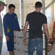 Dyaln Harsh, and Chris Sprang loading up the lambs and getting them weighed