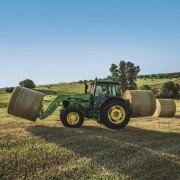 The multi-purpose 6E Series Tractors are perfect for handling jobs around beef or dairy farms.