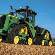 The new 9RX 4-track tractors from John Deere provide superior power, performance, and ride quality when operating in the field.