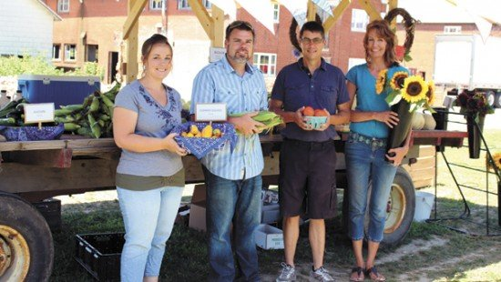 Pictured (left to right) are Rose Hartschuh, Chris Schimpf, Kent Stuckey and Laura Stuckey, who manage different aspects of The Pickwick Place along with Greg Hartschuh, Andrea Schimpf and Ethan Stuckey. Their focus for the summer was the produce stand and beginning renovations on the buildings.