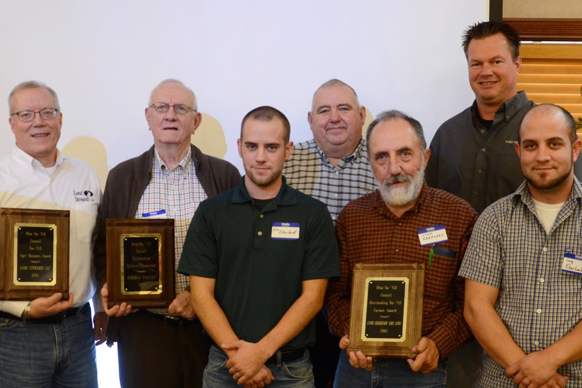 2015 No-Till Council award winners recognized: Mark Wilson, Land Stewards, LLC. (left) Business/Industry Award; Norm Fausey, USDA-ARS, (second from left) Educator/Researcher Award; Lynn Eberhard (center) and his sons, Outstanding No-Till Farmer.