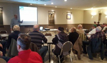 Mike Zuzolo visits with Van Wert area farmers about grain markets