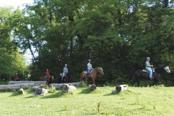 Through horse-related activities like trail riding, Marmon Valley Farm entertains and educates visitors.