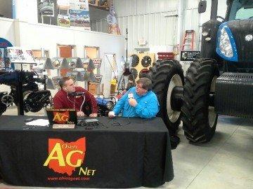 Dale Minyo talks with Bill Apple at the Apple Farm Service covington location.
