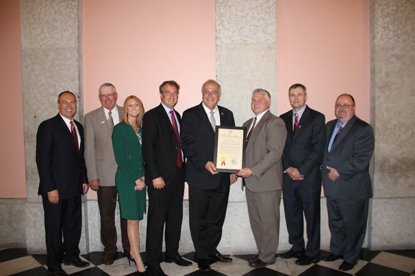 Leaders representing AgCredit and Farm Credit Mid-America were honored with a resolution presented to them by the Ohio Senate recognizing the 100th anniversary of the passage of the Federal Farm Loan Act of 1916. Participating in the presentation of the resolution were (left to right) State Senator Bob Peterson (R-Washington Court House), resolution co-sponsor; Lowell Hill, Farm Credit Mid-America board of directors, DeGraff; Tara Durbin, senior vice-president, Farm Credit Mid-America, Utica; Bill Patterson, Farm Credit Mid-America board of directors, Chesterland; State Senator Cliff Hite (R-Findlay), resolution sponsor; Scott Schroeder, chair, AgCredit board of directors, Leipsic; Brian Ricker, president and CEO, AgCredit, Fostoria, and David White, account manager for government relations, AgCredit, Marion.