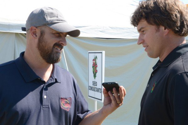 Ty Higgins talks with Matt Hutcheson, a Seed Consultants, Inc. agronomist.