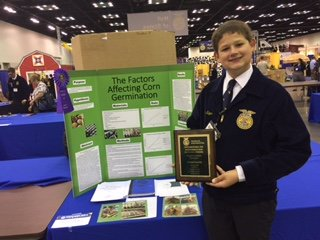 Ethan Kaper placed first in the nation in Plant Systems division 1 at the FFA National Convention agriScience Fair.