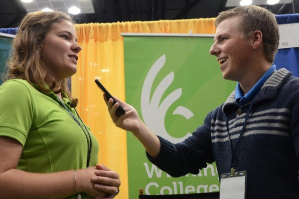 Joel Penhorwood interviews Sara Pope, a Wilmington student, at the trade show.