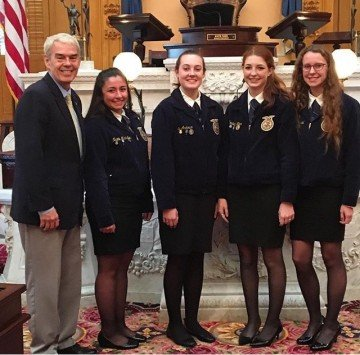 Senator Randy Gardner met with Anthony Wayne FFA Officers Nicole McMullen, Kalie Anderson, Marleigh Kerr, and Haley Schmersal at the Ohio FFA Legislative Leadership Conference. He took the Anthony Wayne FFA members on a special trip to the Senate floor during the conference.