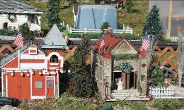 A miniature lighted village features handcrafted buildings and is another popular feature with visitors.