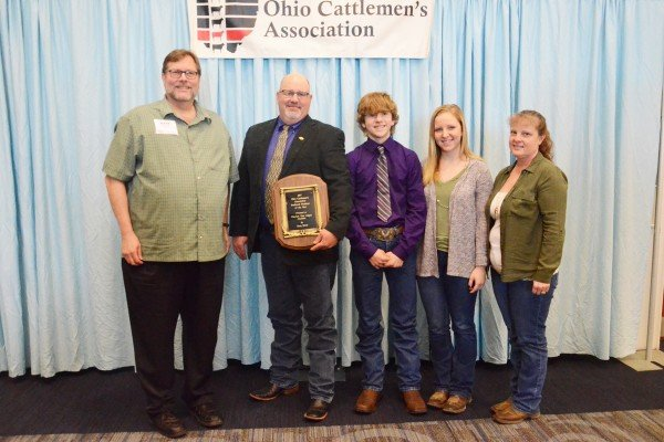 "Dave Felumlee and family with Claylick Run Angus Genetics in Licking County were recognized with the Seedstock Producer of the Year Award presented by Mark Butzow of ""Farm World."""
