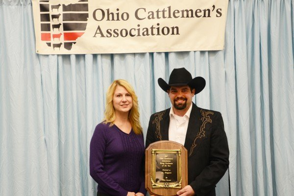 "J.L. Draganic of Fayette County was named the Young Cattleman of the Year presented by Jennifer Kiel of the ""Ohio Farmer."""